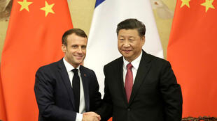 French President Emmanuel Macron with China's President Xi Jinping in Beijing, 6 November 2019.