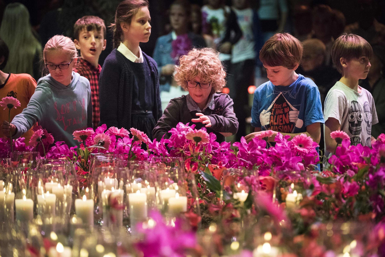 Родственники погибших на траурной церемонии в Амстердаме. Ноябрь 2019 г.