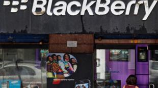A customer walks into a BlackBerry store in Mumbai