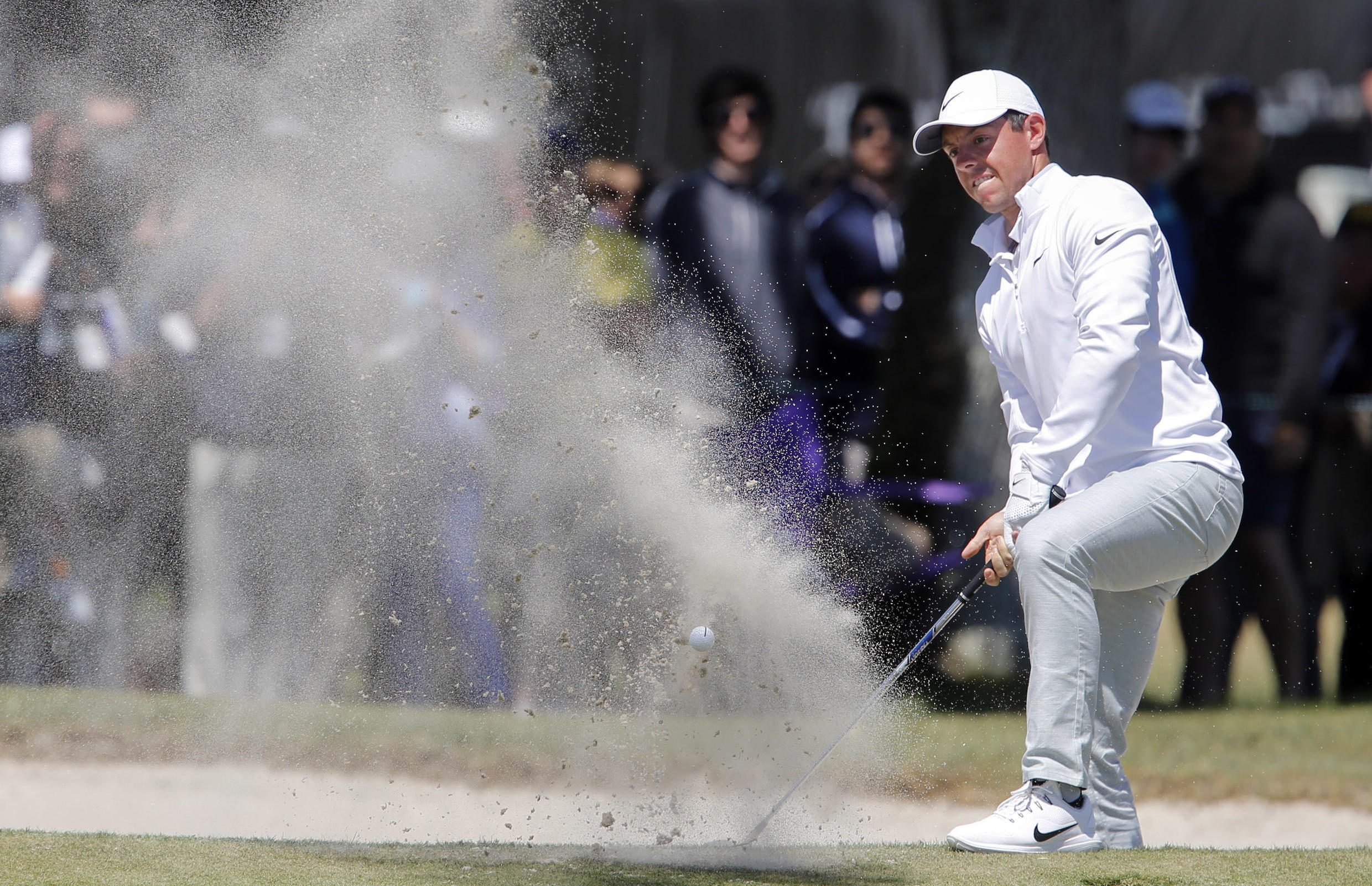 Rory McIlroy frees himself from a bunker on the ninth hole during the second round of the Arnold Palmer Invitational