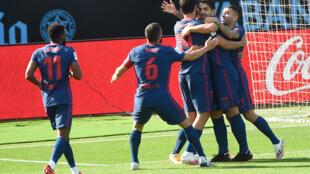 Luis Suarez (C) celebrates after scoring against Celta Vigo on Saturday.