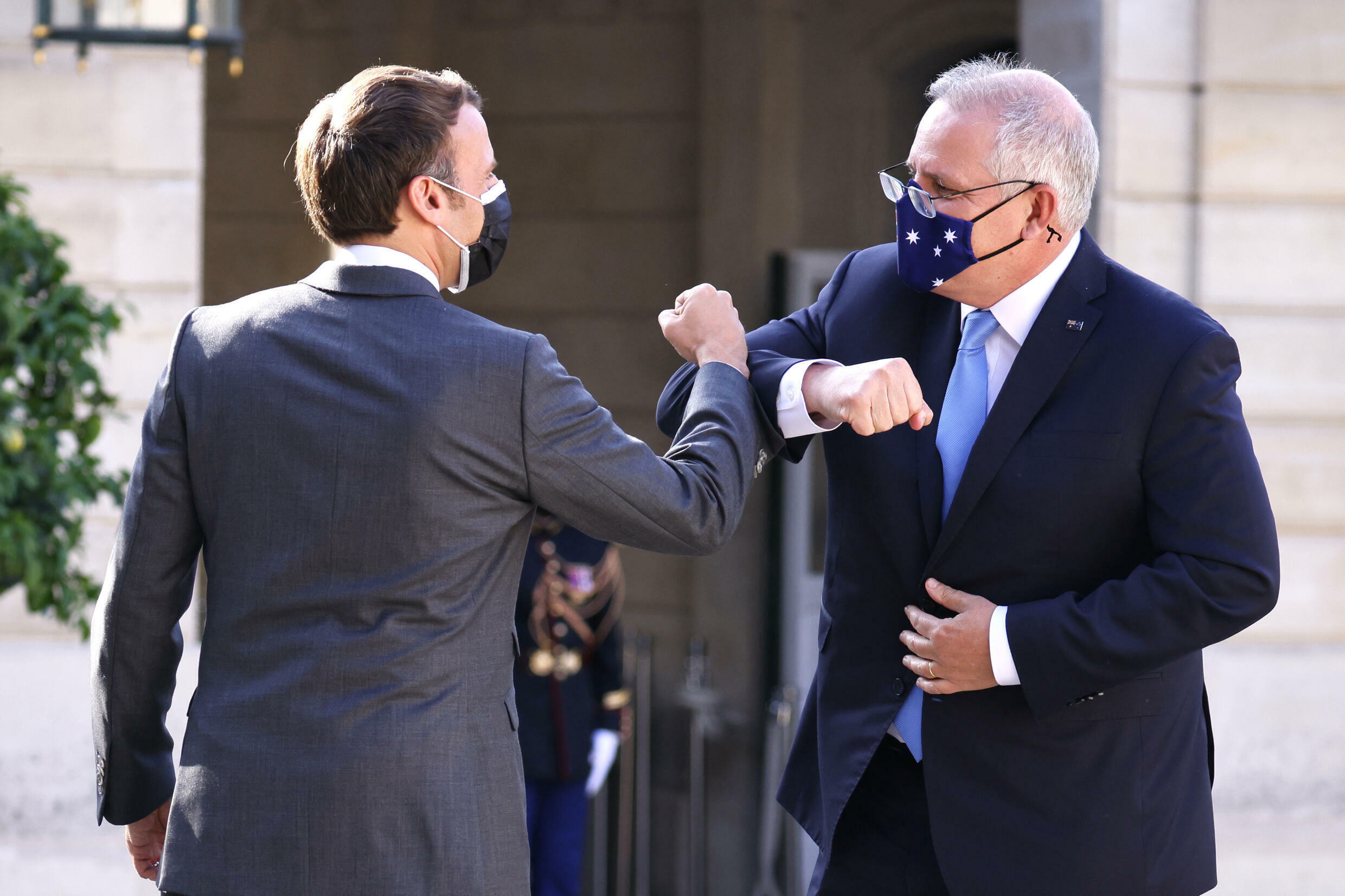French President Emmanuel Macron greets Australia's Prime Minister Scott Morrison at the Elysee Palace in Paris on June 15, 2021