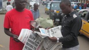 Newspaper vendor, Sorie Kamara, in Freetown