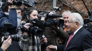 Dominique Strauss-Kahn faces the cameras outside the court in Lille