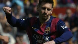 Après son triplé face au Rayo Vallecano, Lionel Messi rejoint Cristiano Ronaldo en tête du classement des buteurs de la Liga (30 buts), le 8 mars 2015.