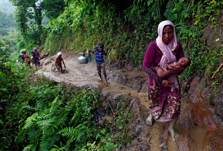Rohingya refugees climb up a hill after crossing the Bangladesh-Myanmar border in Cox's Bazar, Bangladesh September 8, 2017.