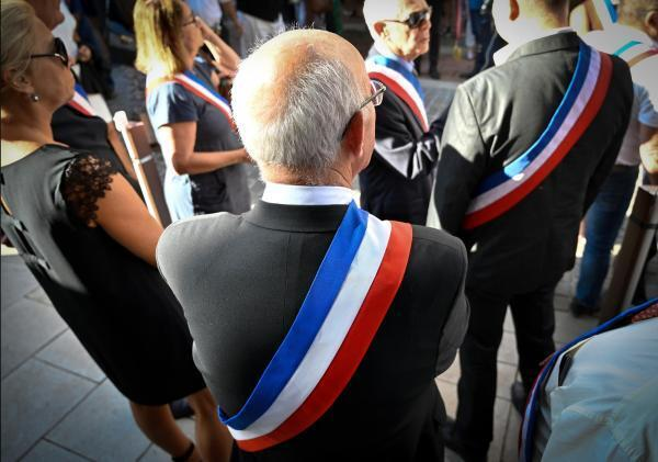 Mayors and officials wear sashes during official functions, like mariages, or funerals.