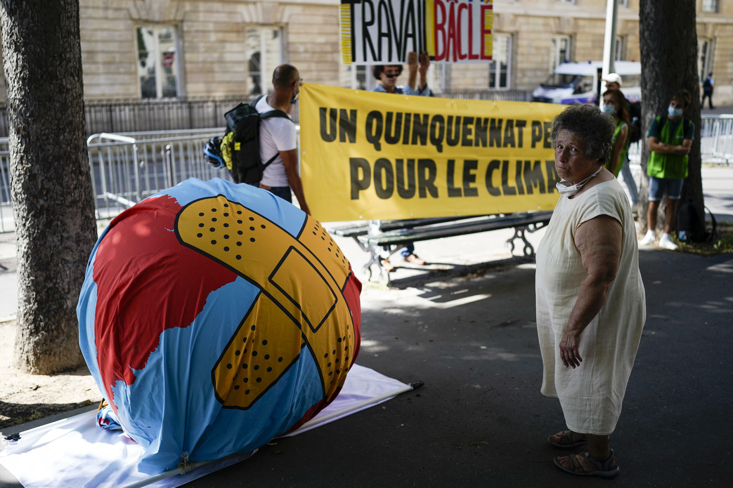 Climate activists demonstrated outside the National Assembly in Paris on Tuesday, as the parliament held a final vote on the climate bill.