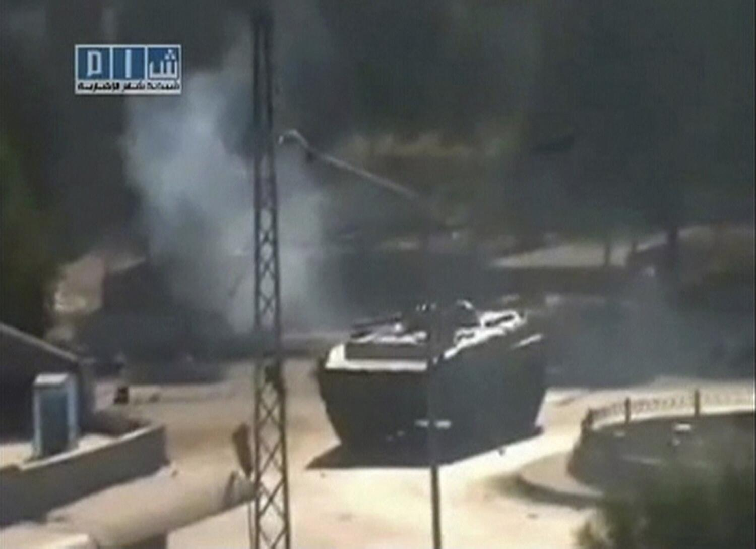 A tank at Al-Bahra roundabout in Hamaon 3 August