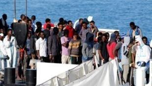 "Migrants disembark Italian coast guard vessel ""Diciotti"" as they arrive at the port of Catania, Italy, June 13, 2018. REUTERS"