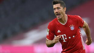 Bayern Munich striker Robert Lewandowski celebrates after scoring twice on Sunday