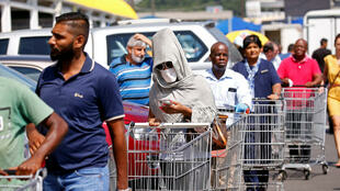 Shoppers queue to stock up on groceries at a Makro Store ahead of a nationwide 21 day lockdown in an attempt to contain the coronavirus disease (COVID-19) outbreak in Durban, South Africa, March 24, 2020.