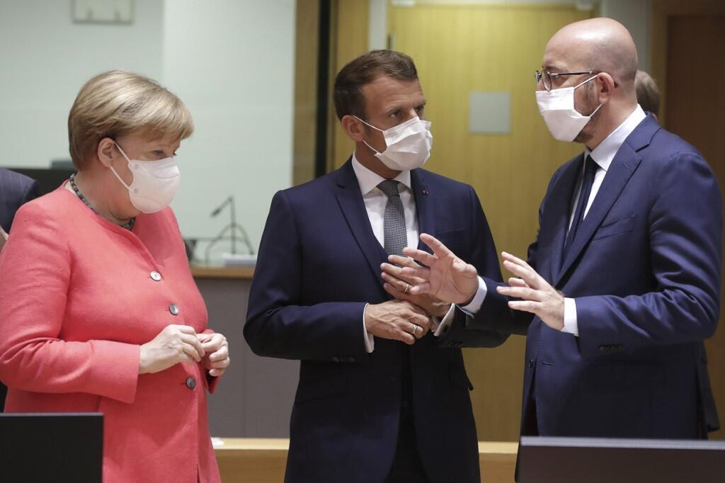 Germany's Chancellor Angela Merkel, France's President Emmanuel Macron and President of the European Council Charles Michel talks prior the European Union Council in Brussels on July 17, 2020.