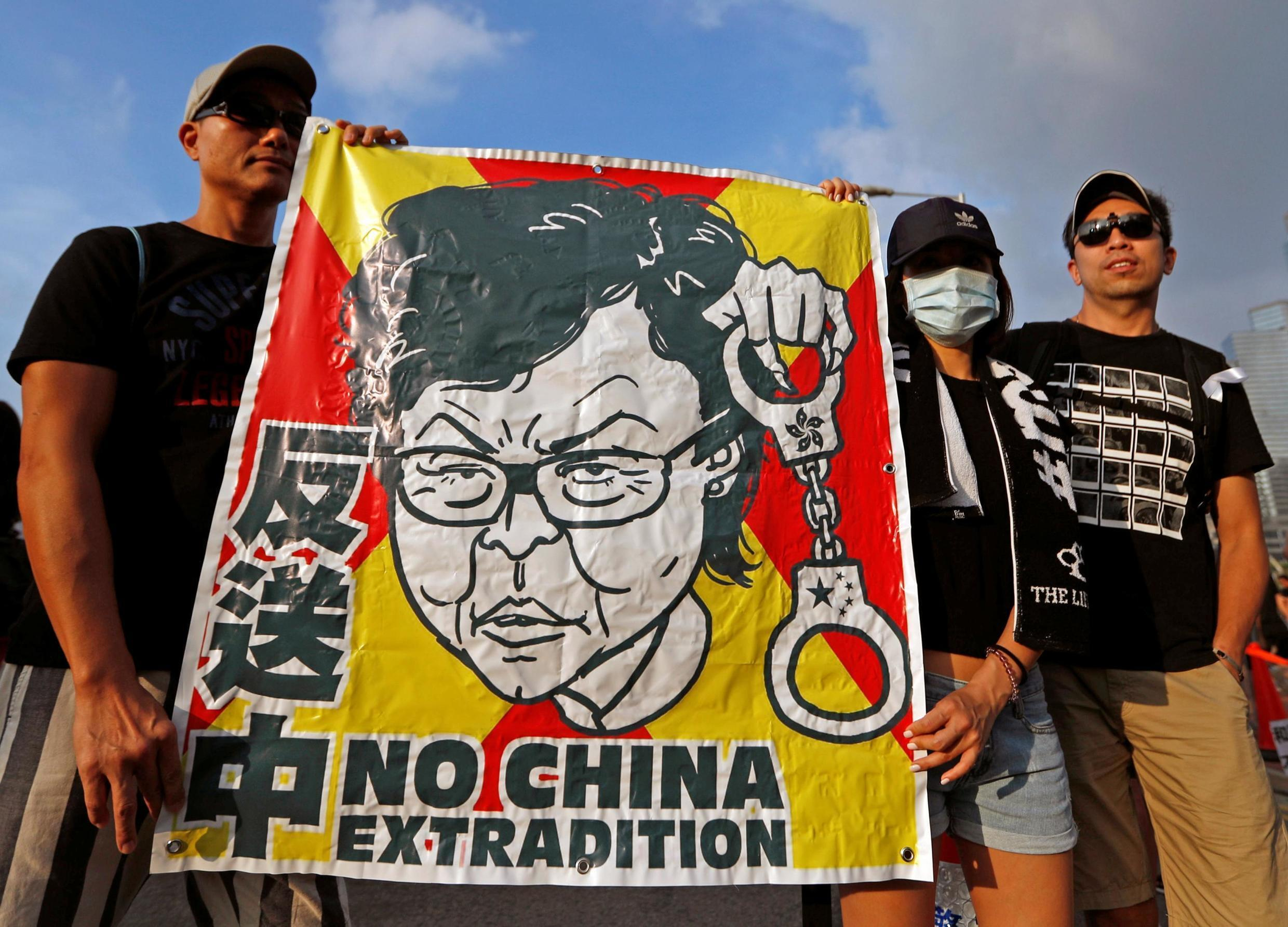 Protesters hold a placard as they attend a demonstration demanding Hong Kong's leaders to step down and withdraw the extradition bill, in Hong Kong, China, June 16, 2019.
