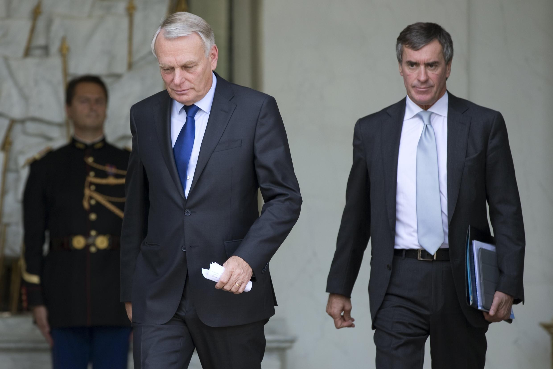 Премьер-министр Франции Жан-Марк Эро и министр бюджета Жером Каюзак после заседания совета министров, 28 сентября 2012