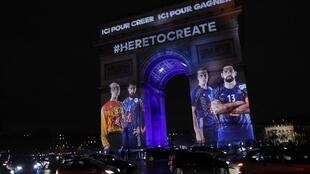 Pictures of French handball players are projected onto the Arc de Triomphe to launch the 25th World Men's Handball Championship in Paris on January 10, 2017.