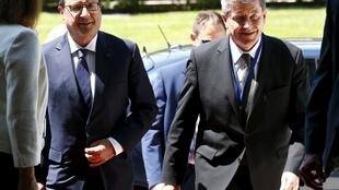 French President Francois Hollande (L) and General-Director of the International Labour Organisation (ILO) Guy Ryder arrive at the UN for their World of Work Summit in Geneva, Switzerland, June 11, 2015.