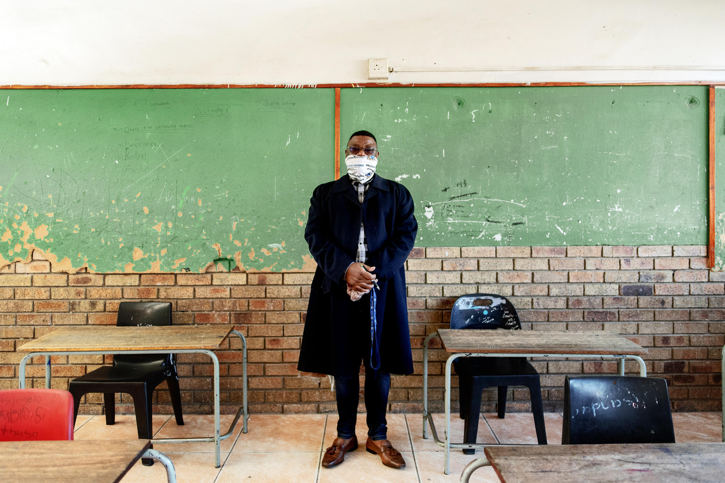 Mr. Gwala, headmaster of the Ithute Higher Primary School, poses for a portrait in an empty classroom in Alexandra, Johannesburg, on June 1, 2020.