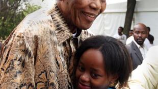 Nelson Mandela hugs his great granddaughter Zenani, in Diepkloof, Soweto, in 2008