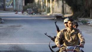 Un combattant de l'Armée syrienne libre, le 16 mai 2013 à Deir al-Zor.