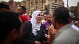 As eleições presidenciais mobilizam os egípcios em debates acalorados na praça Tahrir, conforme mostra a imagem feita neste sábado 27 de maio no Cairo.