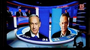 以色列大选,出口民调显示,利库德集团与蓝白党势均力敌。