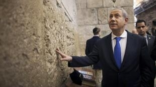 Israel's Prime Minister Benjamin Netanyahu at the Western Wall in Jerusalem's Old City after casting his ballot for the parliamentary election 22 January 2013