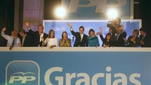 People's Party  leader Mariano Rajoy (C) waves to supporters
