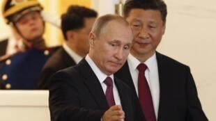 Les présidents Xi Jinping Vladimir Poutine, le 4 juillet dernier à Moscou.