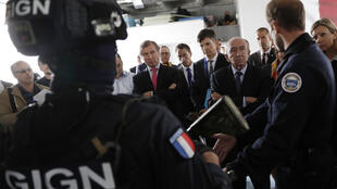 French Interior Minister Gerard Collomb (C) visits the headquarters of the National Gendarmerie Intervention Group (GIGN), the elite tactical unit of the Gendarmerie, on September 20, 2017 in Satory, west of Paris.