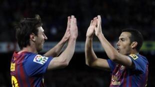 'Yan Wasan Barcelona, Pedro Rodriguez  Lionel Messi a lokacin da suke tabewa bayan Pedro ya zirara kwallo a ragar Getafe