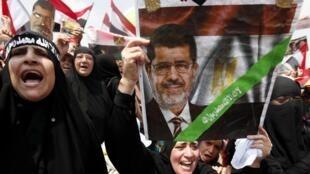 Des partisans de Mohamed Morsi, le 19 juillet au Caire.