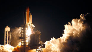 The space shuttle Discovery lifts off from the launch pad  at the Kennedy Space Center in Cape Canaveral, Florida
