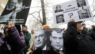People rally in support of jailed Russian former oil tycoon Mikhail Khodorkovsky in front of the court building in Moscow