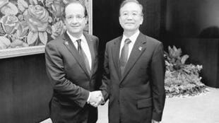 دیدار رییس جمهوری فرانسه با نخست وزیر چین در لائوس