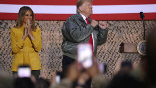 US President Donald Trump, accompanied by First Lady Melania Trump, addresses US troops in an Iraq military base, 27 December