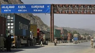 NATO lorries en route for Afghanistan, blocked on the Pakistani border in October 2010