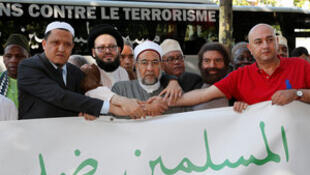French-Jewish writer Marek Halter (2nd R), Imam Hassen Chalghoumi (L) at the start of the march