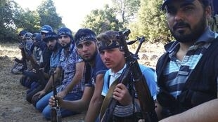 Des membres de l'Armée syrienne libre à Damas, le 13 août 2012.