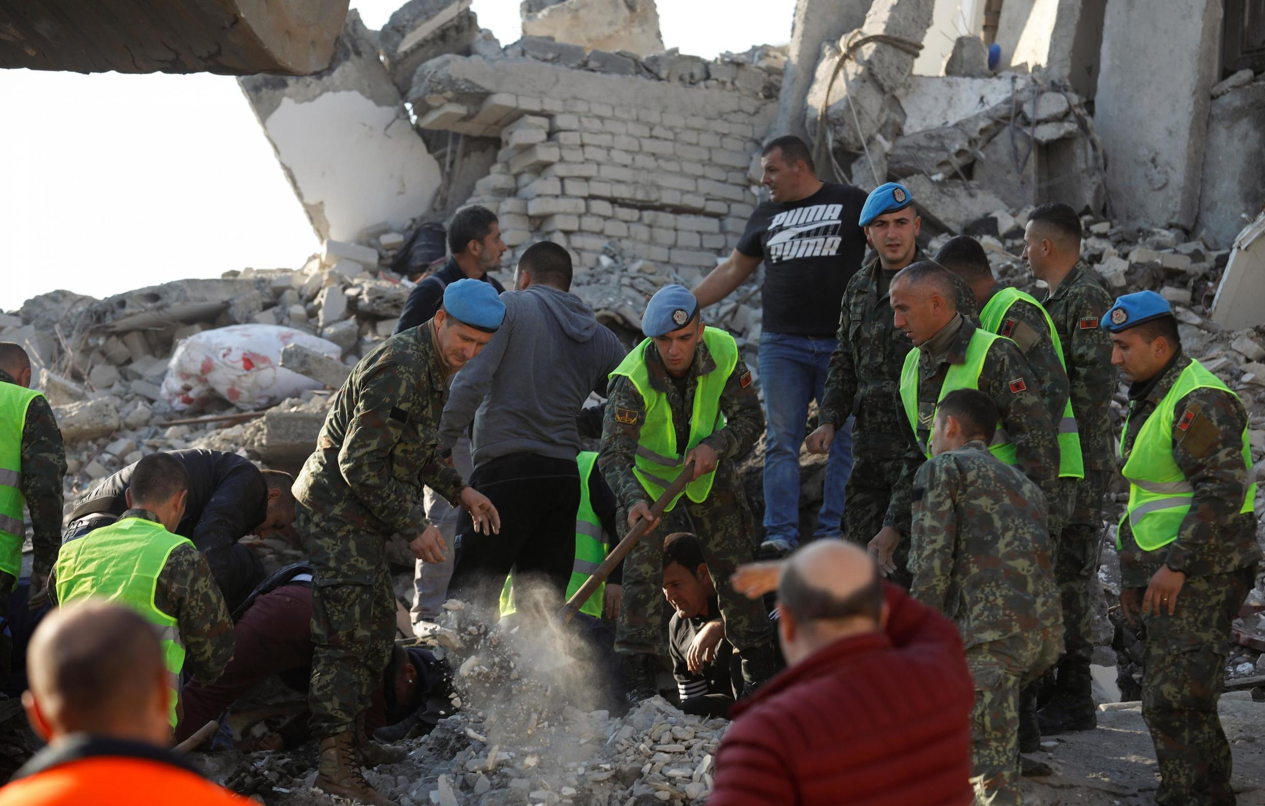 Rescuers sift through rubble in Albania after the earthquake, 26 November 2019