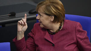 German Chancellor Angela Merkel urged German to rally behind her and respect new curbs to fight coronavirus