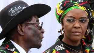 President Robert Mugabe and his wife Grace attend a rally of his ruling ZANU (PF) in Chinhoyi, Zimbabwe, July 29, 2017.