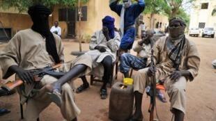 Les combattants du Mujao (photo) et de Boko Haram utilisent souvent de faux passeports camerounais ou maliens pour pouvoir circuler librement en Afrique de l'Ouest et en Afrique centrale.