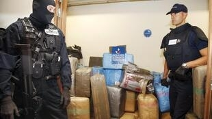 rench armed customs officers stand guard in front of a storage room with seized cannabis in Paris, France October 18, 2015. French police seized more than seven tonnes of cannabis overnight in vehicles parked on a street in the west of Paris in 2015.