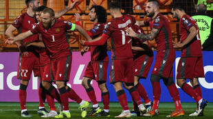 It was a night of celebration for Armenia on Wednesday as they beat Romania to go top of their World Cup qualifying group ahead of Germany