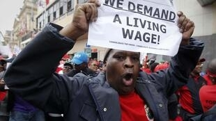 Striking South African public service workers march through the streets of Cape Town, August 26, 2010.