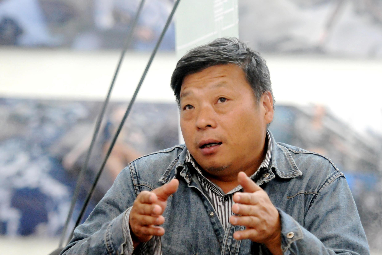 Nhiếp ảnh gia Lô Nghiễm, ảnh chụp năm 2014.