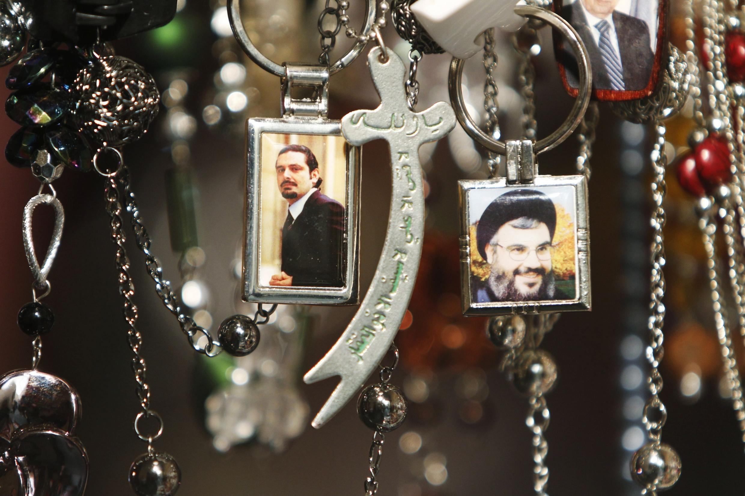 Pictures of Lebanon's Hezbollah leader Nasrallah and Lebanese caretaker Prime Minister al-Hariri are seen on key rings at a gift shop in Sidon