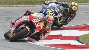 Honda's Marc Marquez (front) and Yamaha's Valentino Rossi in Malaysian MotoGP earlier this year