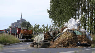 Farmers block the road leading to the Mont-Saint-Michel in Normandy